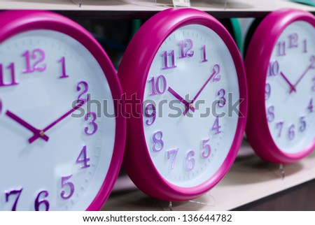 Several wall clocks on the shelf