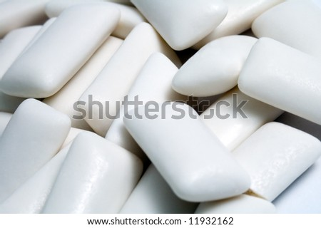several white chewing gums, detail photo