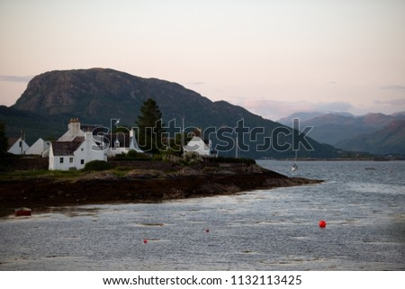 Several white houses at sunset in a vacation hotspot - small town of Plockton, Highlands,Scotland