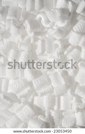 several white styrofoam packing peanuts close up shot - stock photo