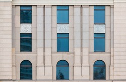 Several windows in a row on facade of urban office building front view, St. Petersburg, Russia
