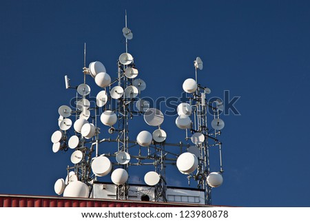 Several wireless, satellite and mobile phone antennas