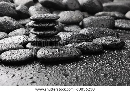 several zen black stones with water drops - stock photo