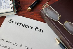 Severance Pay definition written on a paper.