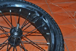 Severely damaged bicycle alloy wheel rim and over-inflated tyre.
