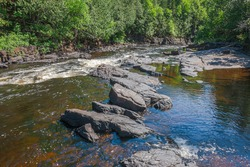 Sevignys Creek Falls Conservation area Thunder Bay Ontario Canada featuring beautiful creek, forest and rapids on summer