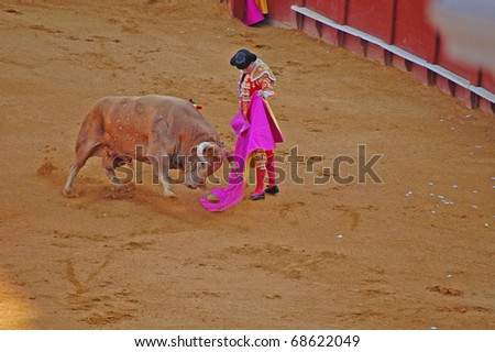 "SEVILLE - APRIL 30:  A bull charges Bullfighter David Fandila ""El Fandi"" during a fight for a sold out crowd at the Plaza de Toros de Sevilla April 30, 2009 in Seville, Spain."