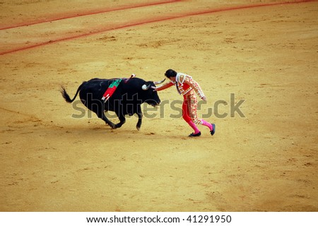 "SEVILLE - APRIL 30:  Bullfighter David Fandila ""El Fandi"" fights for a sold out crowd at the Plaza de Toros de Sevilla on April 30, 2009 in Seville, Spain. - stock photo"