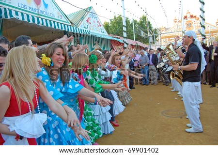 SEVILLE - APRIL 28: Spontaneous celebrations of music and dance erupt during the Feria de Abril on April 28, 2009 in Seville, Spain.