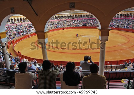 SEVILLE - APRIL 30:The ring is prepared as the spectators enter the stadium at the Plaza de Toros de Sevilla April 30, 2009 in Seville, Spain.