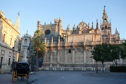 Seville Cathedral in morning. Triumph Square (Plaza del Triunfo), Seville, Andalusia, Spain, Western Europe.
