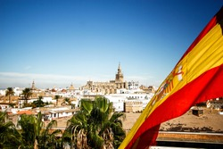 Seville cathedral with Spain flag in Sevilla , Spain