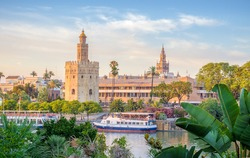 Seville is divided in two by the river Guadalquivir. On the east side it is located the Golden Tower, the cathedral and its tower called Giralda.