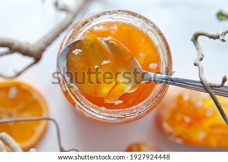 Seville Orange, Sour Orange, Bitter Orange, Marmalade Orange - native Southeast Asia tropical fruit.  Homemade Tasty Jam on white background. Healthy Food.