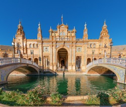 Seville, Plaza de espana, fountain and building with colorful bridges. Andalucia, Spain