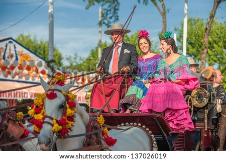 SEVILLE, SPAIN - APR, 25: Parade of carriages at the Seville's April Fair  on April, 25, 2012 in Seville, Spain
