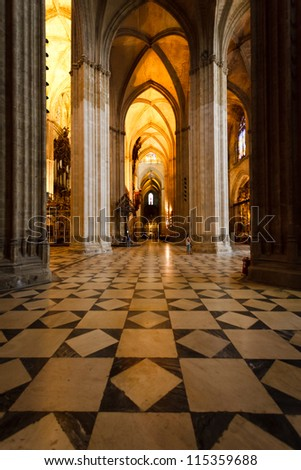 SEVILLE, SPAIN - MAY 1,2010: illuminated cathedral highlighting magnificent gothic arches marble floor on May 1, 2010 in Seville Spain A New UNESCO World Heritage Site report commits to preservation