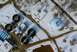 Sewage aerial view of a wastewater treatment processing plant sewage farm surrounding industrial of water treatment in winter season