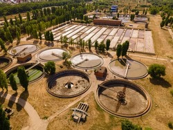 Sewage treatment plant. Sedimentation round basin or clarifier in modern sewage or wastewater treatment plant