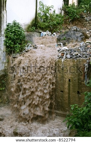 sewage water flowing into drain, rishikesh, india