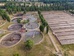 Sewage water recycle. Sedimentation tanks in a sewage treatment plant, Aerial view