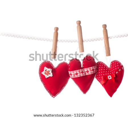 Sewed handmade red hearts on lace isolated
