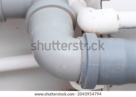 Sewer pipes in home, connection of grey polipropilen pipes for wash basin, washbowl drain Photo stock ©