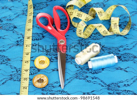Sewing accessories on fabric