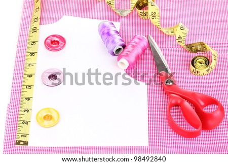 Sewing accessories on fabric isolated on white