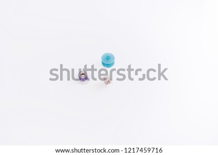 Sewing bobbins on isolated background , three sewing bobbins. Blue bobbin threads, Sewing process. - Shutterstock ID 1217459716