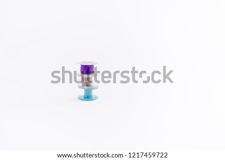 Sewing bobbins on isolated background , three sewing bobbins. Blue bobbin threads, Sewing process. - Shutterstock ID 1217459722