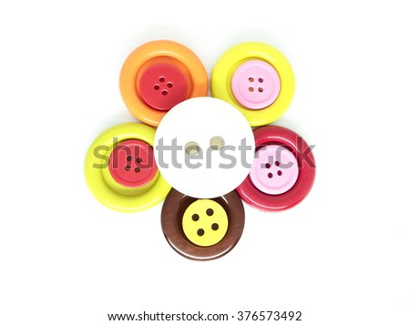 Sewing buttons on white background #376573492