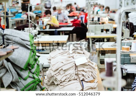 Sewing industry with laborers #512046379
