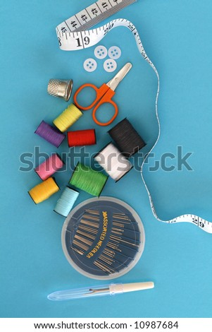 Sewing kid on a blue background