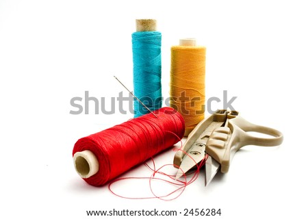 sewing kit of thread, needle and scissors