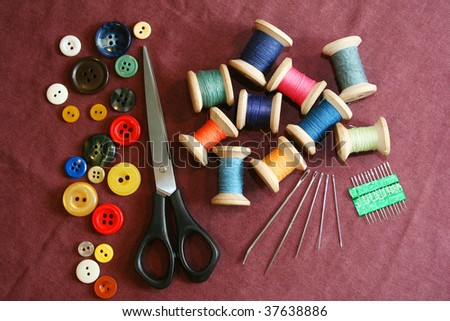 Sewing kit on a cotton cloth