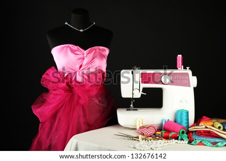 Sewing machine, dummy and other sewing equipment isolated on black