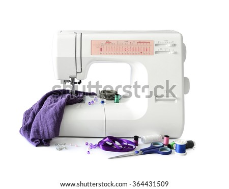 sewing machine with fabric and threads and scissors isolated on white background #364431509
