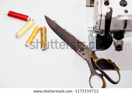 Sewing machine with thread and scissors #1175159713
