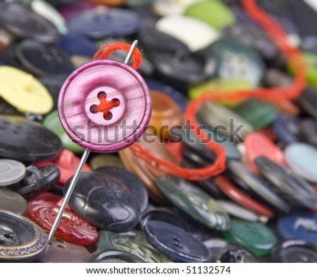 Sewing needle with buttons on background