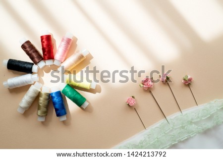 Sewing spools of thread, needles and ribbon. Handmade . All colors of the rainbow. Flat lay, top view #1424213792