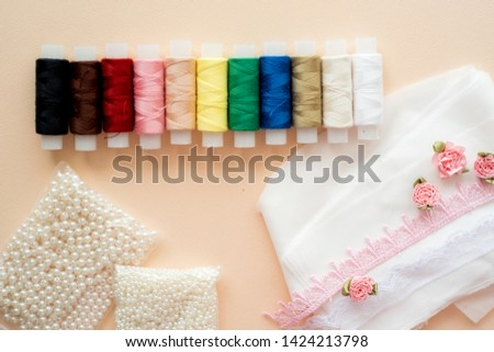 Sewing spools of thread, needles and ribbon. Handmade . All colors of the rainbow. Flat lay, top view #1424213798