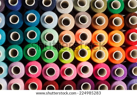 Sewing threads as a multicolored background close up #224985283
