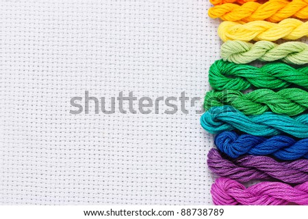 sewing threads for embroidery on white cotton