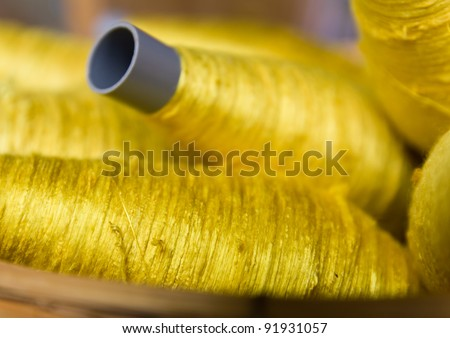 Sewing threads golden color  closeup