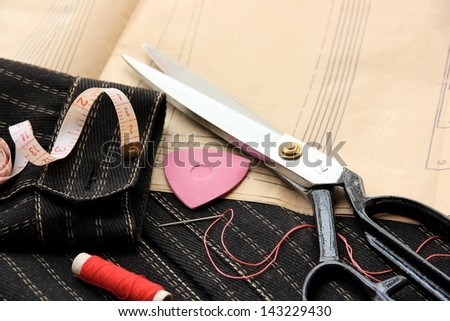 Sewing tools fashion design background.