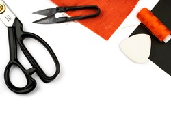 Sewing tools on a white background, scissors, sewing needles, crayon. Crafts, tailoring, cutting clothes