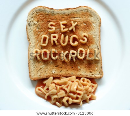 sex drugs rock roll written with alphabetti spaghetti pasta shapes on toast