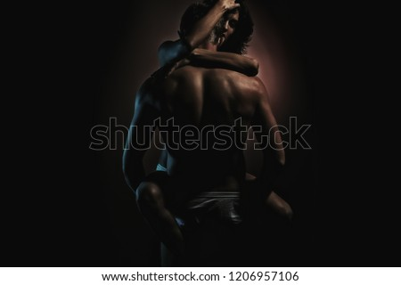 Sex. Passionate couple kissing, boy and girl. Having sex. Young lovers. People in love. Positions kamasutra. Erotic moments. Concept photo. Secret. Fashion. Hot babe. Party. Night background. Sensual.