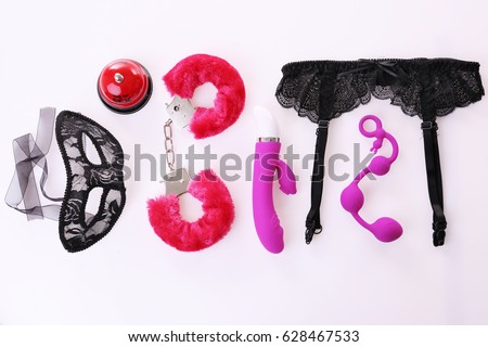 Sex toys and accessories on white background